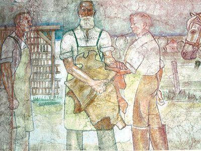 Friedrich Offermann mit zwei Meistern: Ausschnitte aus einem Fries von Barthel Gilles am Gebäude der Gerberei