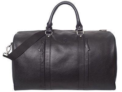 Eine Reisetasche aus Leder ist der Prototyp für Handgepäck, das bei Flugreisen mit an Bord genommen werden darf.